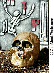 Scary skull with gravestone - A Scary skull with gravestone