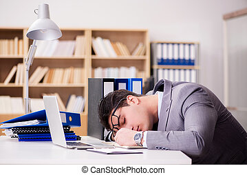 Tired businessman working in the office