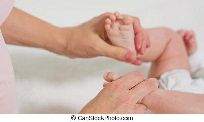 Mother Massaging Little Baby's Feet