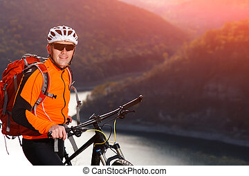 Close-up view photo of mountain cyclist while stands under...