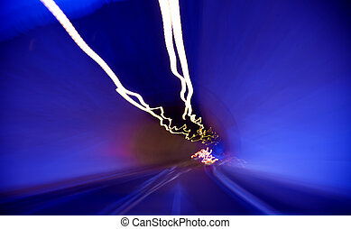 moving through a tunnel abstract with car lights