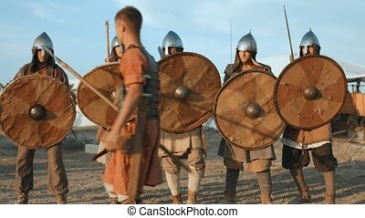 Warriors of Ancient Russia demonstrate the battle scene and...