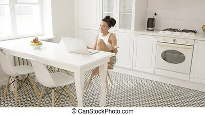 Expressive young woman using laptop - Young beautiful woman...