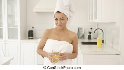 Girl after shower with glass of juice - Young brunette...