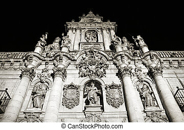 Valladolid - Night view of illuminated university building...
