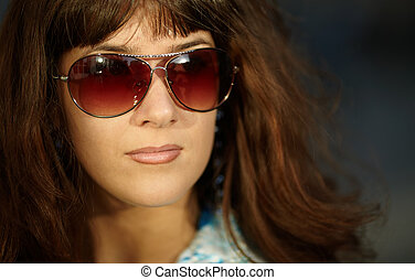 young woman with sun glasses - natural warm sun...