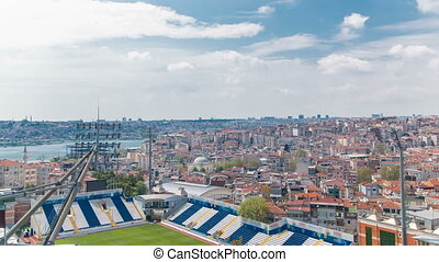 Panoramic top view with stadium and houses timelapse in...