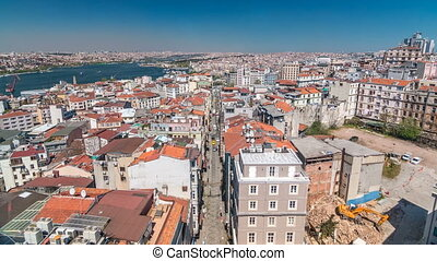 The view from Galata Tower to Golden Horn and city skyline with red roofs timelapse, Istanbul, Turkey