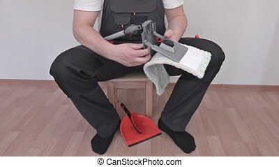 Worker fix brush in room