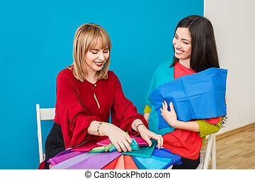 happy stylist with client - stylist doing color analysis of...