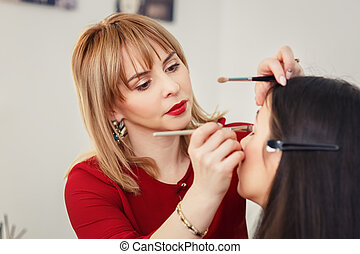 makeup artist apply makeup at eyes - professional makeup...