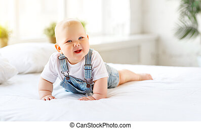 Happy baby toddler in bed