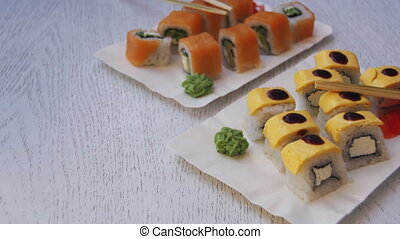 Sushi Rolls in a Restaurant on a Stylish Wooden Table....