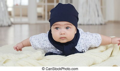 Cute baby boy lying down on blanket - Portrait of cute baby...