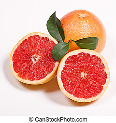 Ripe grapefruit with green leaf