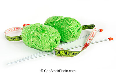 knitting yarn - Two green knitting yarn with spokes and a...
