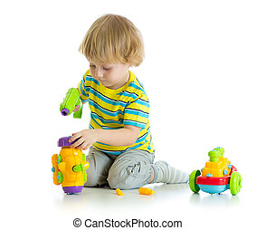 An adorable child playing with educational isolated on white.