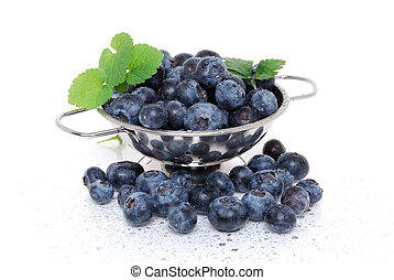 Washed Blueberries - washed blueberries in colander white...