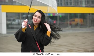 girl with umbrella in windy weather