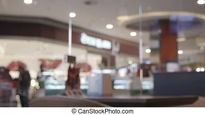 Abstract blurred shop background. Interior with walking...