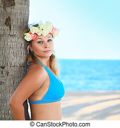 Woman at the beach - Beautiful woman near the trunk of palm...