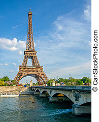 Eiffel Tower and bridge over river in Paris