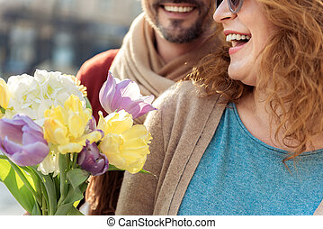 Happy lady getting bouquet from her husband - This is for...