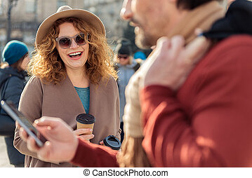 Man using smartphone during date - Portrait of cheerful...