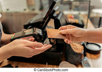 Customer buying food in shop - Close up of female hand...
