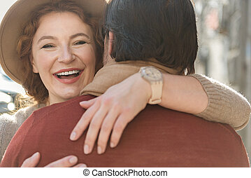 Cheerful loving couple embracing with fondness - Sharing...