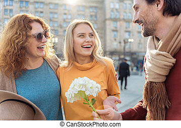 Happy father presenting bouquet to his family - For my...