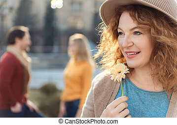 Romantic lady standing outdoors with anticipation - Portrait...