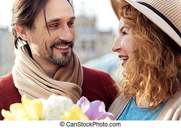 Joyful man giving bouquet to lady - Portrait of happy loving...