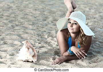 Sunbathing - Young woman sunbathing on the tropical beach