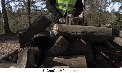 Worker sorting logs close up