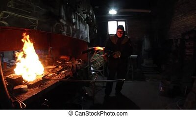 Old forge work with metal products. - Old blacksmith forge...