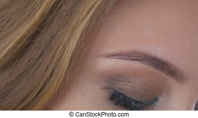 Close up shot of woman's eyes with professional makeup....
