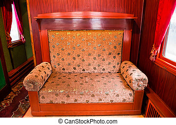 Vintage old sofa in the compartment interior