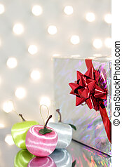 Three red Christmas ball and gift box