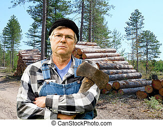 lumberjack portrait against a stack of logs - lumberjack...