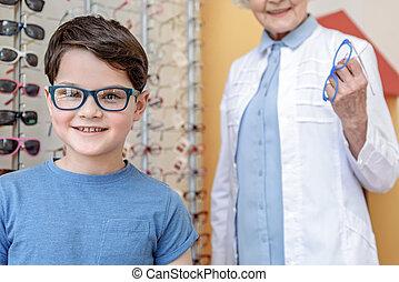 Cheerful kid in trendy eyewear
