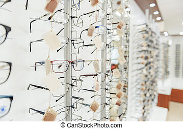 Wide showcase full of glasses - Shop-front with various...