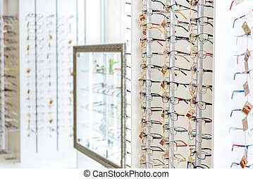 Different types of eyewear on shelves - Various glasses are...