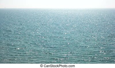 Sea sparkling in the sun. Blue water and horizon. Into the...