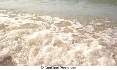 Waves on sandy seashore. Water, sand and sunlight. Time to...