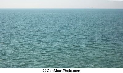 Sea and horizon. Blue water with small waves. To the edge of...