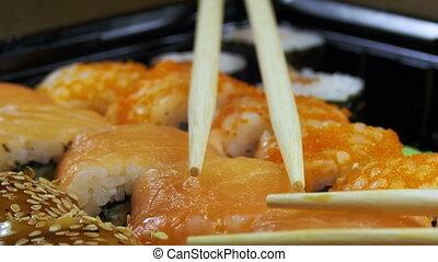 Japanese Sushi Rolls with Chopsticks Rotates