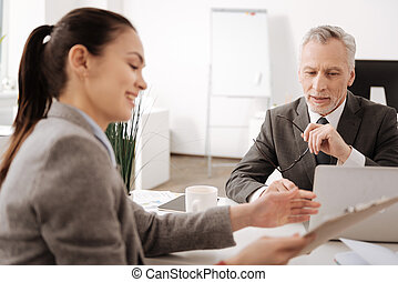 Thoughtful employer listening to his secretary