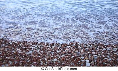 Pebbles on the beach. Texture of the sea shore. The Adriatic...