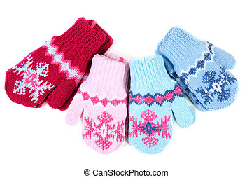 Baby knitted mittens with pattern on white background